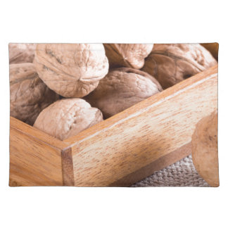 Macro view of walnuts close up in a wooden box placemat