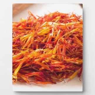 Macro view on fragrant saffron closeup plaque