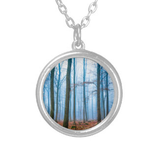 Magic forest in fog in blue and orange silver plated necklace
