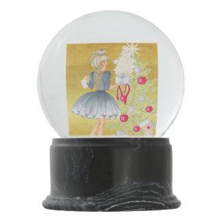 Magic of Christmas - Blonde Decorating A Tree Snow Globe