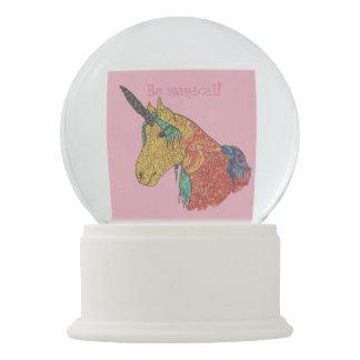 Magical rainbow unicorn snow globe