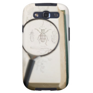 Magnifying glass over book showing insects samsung galaxy SIII covers
