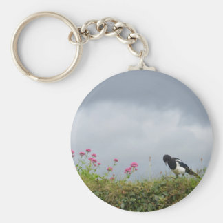 Magpie and wild flowers. key ring