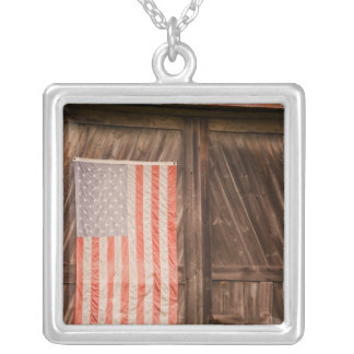 Maine, Faded American flag on door of old barn Square Pendant Necklace