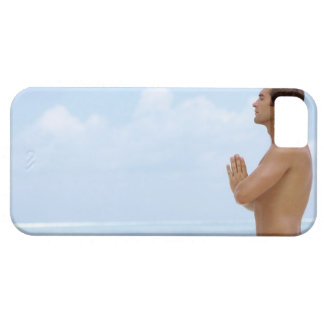 Maldives, Smart young guy practicing yoga at iPhone 5 Cases
