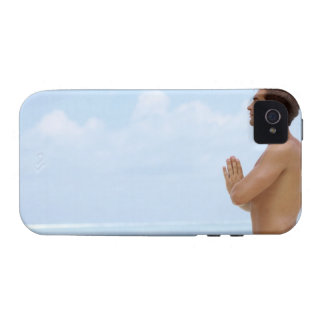 Maldives, Smart young guy practicing yoga at Case-Mate iPhone 4 Cover
