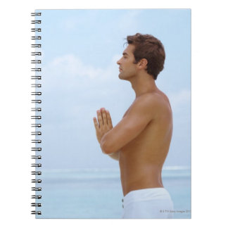 Maldives, Smart young guy practicing yoga at Spiral Notebooks