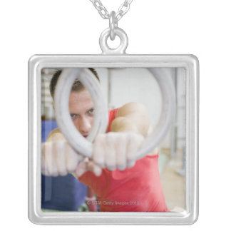 Male gymnast on rings silver plated necklace