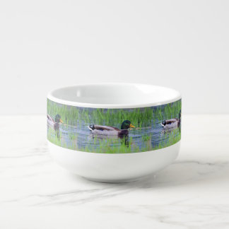 Male mallard duck floating on the water soup mug