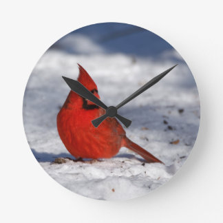 Male Northern Cardinal in the Snow Round Clock