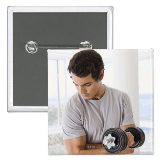 Man doing arm curls with weights 15 cm square badge