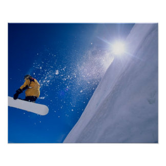 Man flying through the air on a snowboard with poster