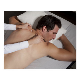 Man having a back massage from woman posters