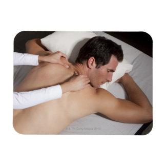 Man having a back massage from woman rectangular photo magnet