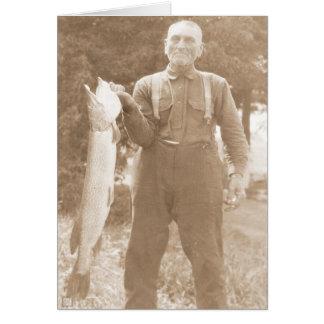Man Holding a Fish Card