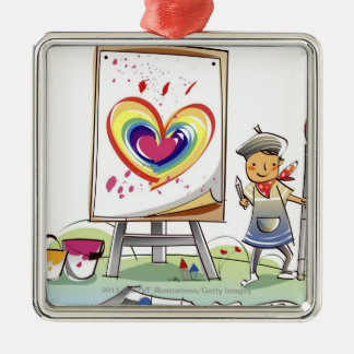 Man holding a paintbrush and standing by an easel metal ornament