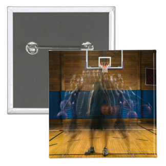 Man holding basketball standing on court, 15 cm square badge