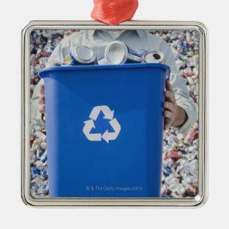 Man holding blue bin metal ornament