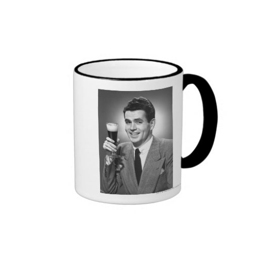Man holding glass of beer in studio B&W Mug