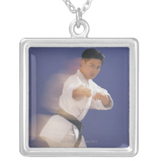 Man in karate stance silver plated necklace