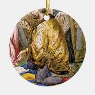 man in yellow kneels ceramic ornament