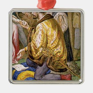 man in yellow kneels metal ornament