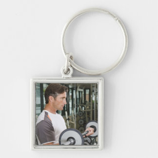 Man lifting weights in gym 2 keychains