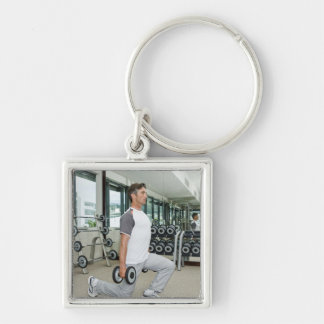 Man lifting weights in gym keychains