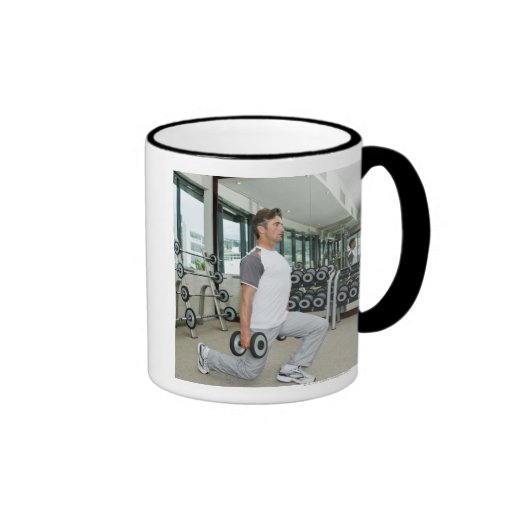 Man lifting weights in gym mugs