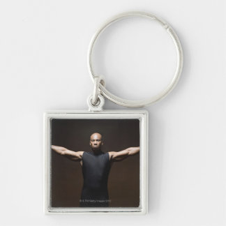Man lifting weights, portrait key chains