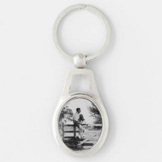 Man On Gate Old Black & White Metal Oval Keychain Keyrings
