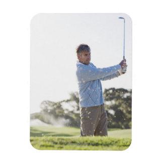 Man playing golf in sand trap rectangular magnet