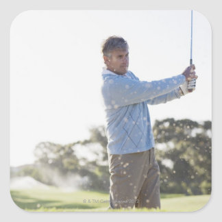 Man playing golf in sand trap square sticker