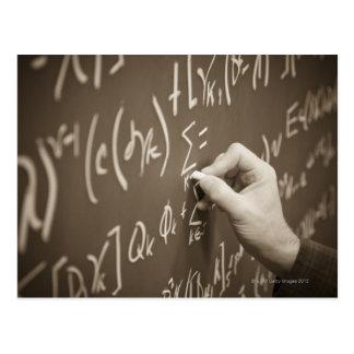 Man printing math equations on a chalkboard postcard