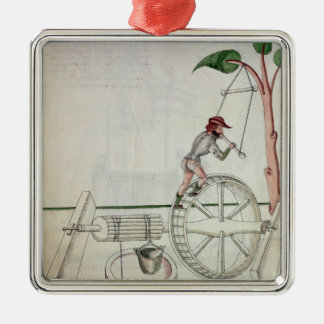 Man Putting into Motion a Wheel-Driven Well Square Metal Christmas Ornament