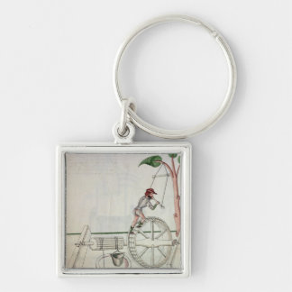 Man Putting into Motion a Wheel-Driven Well Silver-Colored Square Key Ring