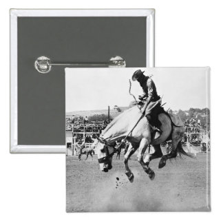Man riding bucking horse in rodeo 15 cm square badge