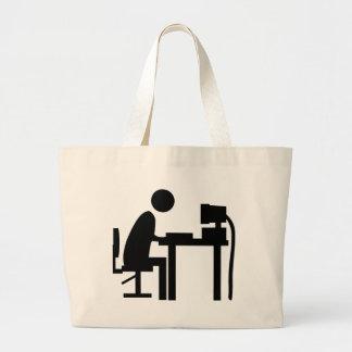 Man sat at a computer. jumbo tote bag