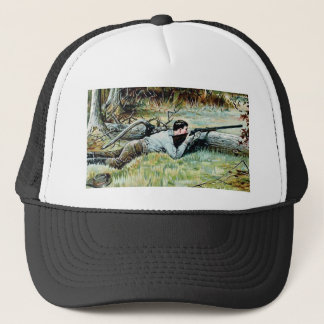 man shoot over a log trucker hat