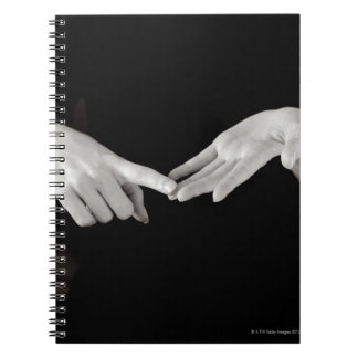 Man signing letter o in British sign language, Notebook