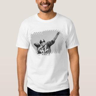 Man throwing football tshirts