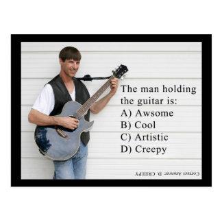 man with guitar postcard