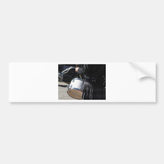 Man with kilt playing on drums bumper sticker