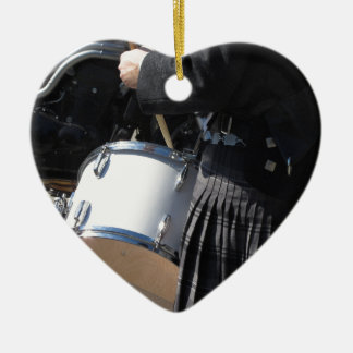 Man with kilt playing on drums ceramic heart decoration
