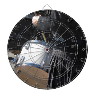 Man with kilt playing on drums dartboard