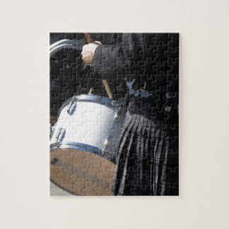 Man with kilt playing on drums jigsaw puzzle
