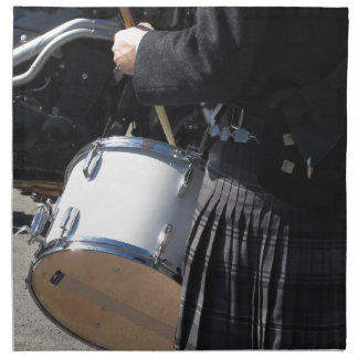 Man with kilt playing on drums napkin