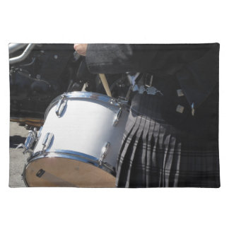 Man with kilt playing on drums placemat