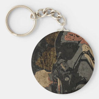 Man with protective mask on dark metal plate key ring