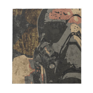 Man with protective mask on dark metal plate notepad